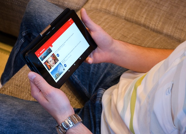 person watching youtube video on tablet