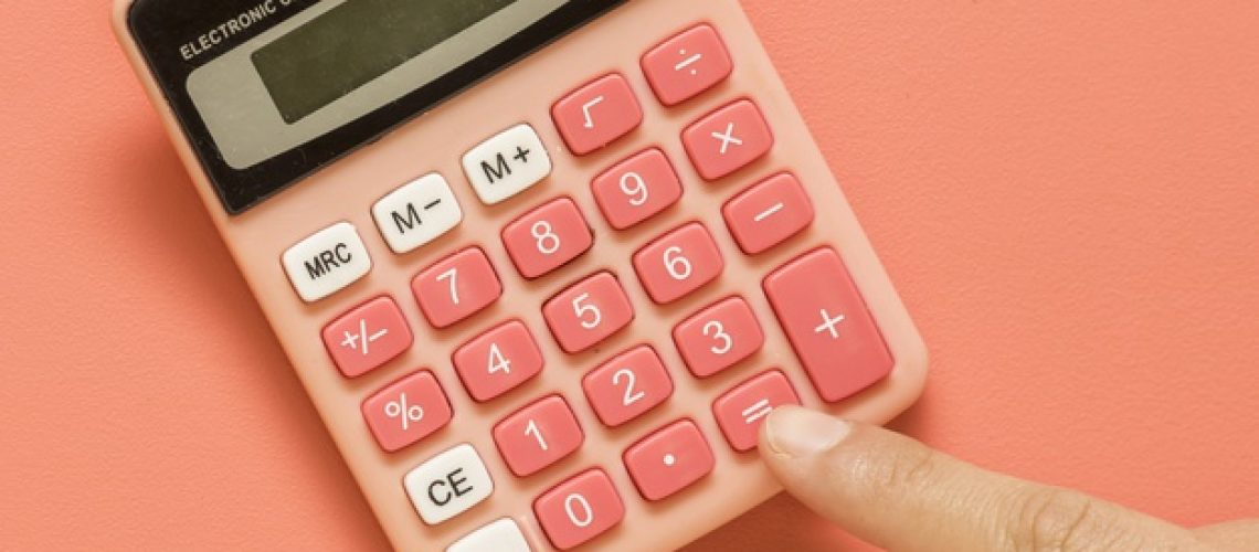 hand-with-pink-calculator-colored-surface_23-2148182046